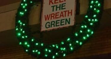 Wreath's single red light bulb reminds residents about fire hazards